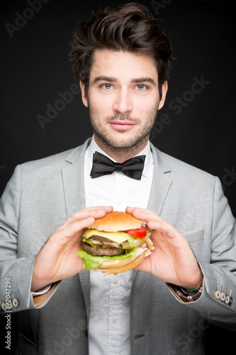 canvas print picture Mann isst Burger