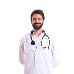Happy doctor over white background