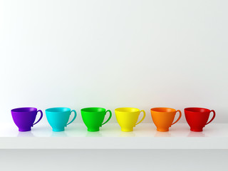 Rainbow cups on the shelf.