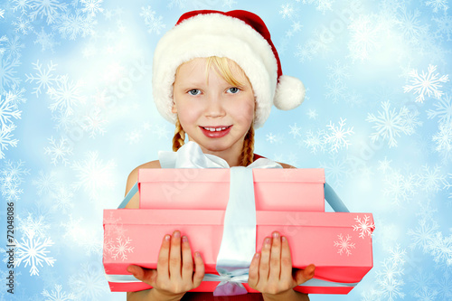 canvas print picture Smiling girl in Santa hat