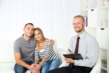 Young happy couple after therapy session with family