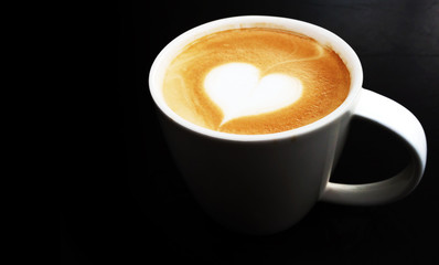 Cup of latte art coffee heart symbol