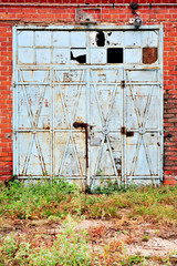 Industrial detail with old warehouse gate