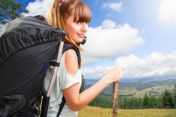 young beautiful woman hiker on mountain in summer