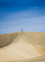 Gymnastic on the dunes sand