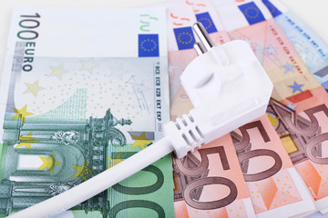 Cord with plug on euro banknotes background