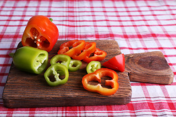 Pepper on cutting board on fabric background