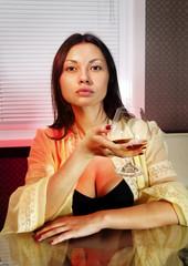 sad woman with glass of brandy