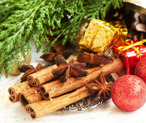 Cinnamon and Anise Spices with Christmas Decoration and Fir Tree