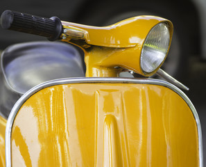 Yellow vintage motorcycle. Color image