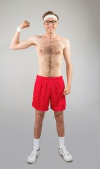 Geeky shirtless hipster flexing bicep