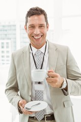 Smiling businessman during break time in office