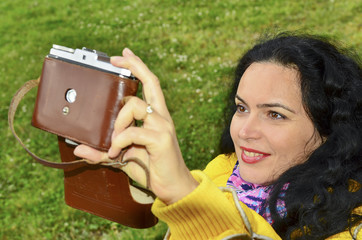 Brunette woman with old film photo camera collection