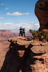 Couple standing at an edge of a canyon