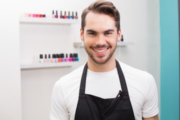 Handsome hair stylist smiling at camera