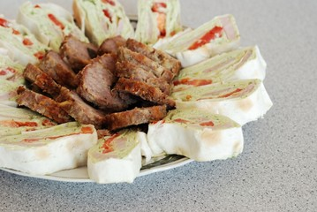 pita stuffed with fish and meat in a white plate