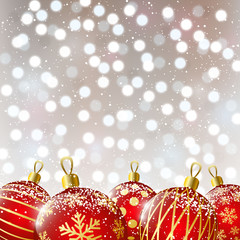 Red Christmas balls on shiny background