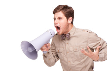Angry businessman screaming with loud-speaker
