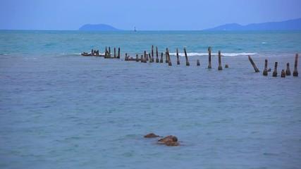 Pegs into the sea on coast of Koh Samui. Thailand. HD. 1920x1080