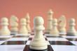 Chess piece white pawn against white chess pieces.