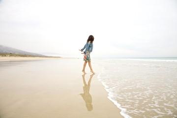 jeans jacket woman touching sea