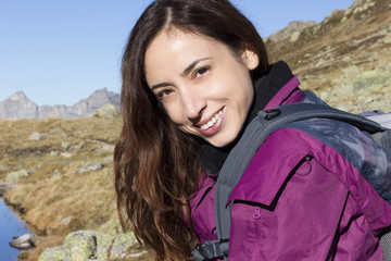 Young woman on a mountain trip