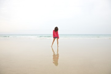 red jersey woman at beach