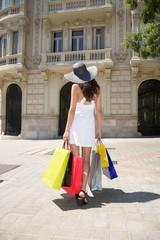 white dressed woman with shopping bags