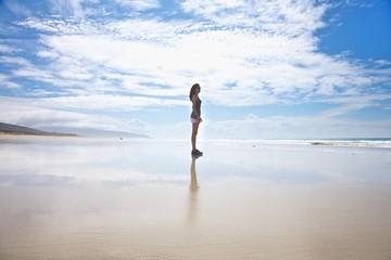 white shorts woman standing on seashore