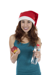 Christmas woman with an apple and water
