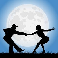 coppia di ballerini sotto la luna piena