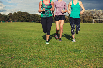 Three women running in the park