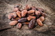Cocoa beans on wooden background. Organic food - 72064055