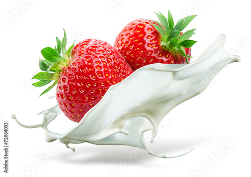 Two strawberries falling into milk. Splash isolated on white bac - 72064033