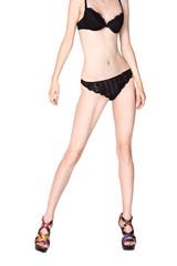 Slender female figure in black lingerie