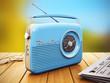 Leinwanddruck Bild - Old radio on wooden table outdoors