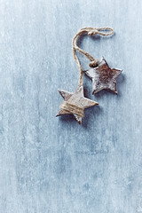 Two wooden Christmas stars