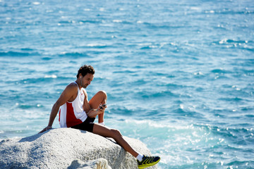 Male runner enjoying amazing sea view and sunny day