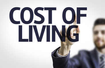 Business man pointing the text: Cost of Living