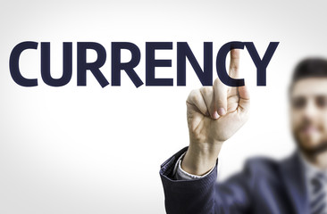 Business man pointing the text: Currency