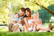 canvas print picture - Happy family enjoying in the park