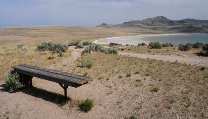 Bench on a desert hill overlooking the Great Salt Lake