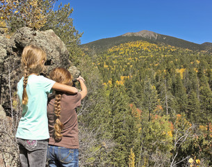 A Pair of Girls Admires a View of Agassiz Peak