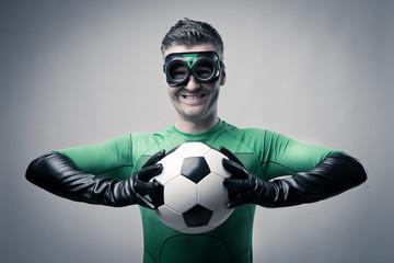 Superhero with soccer ball