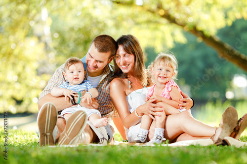 canvas print picture Happy family enjoying in the park