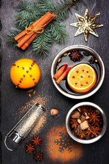Christmas mulled wine with spices on slate blackboard