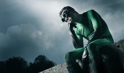 Pensive green superhero