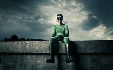 Smiling green superhero