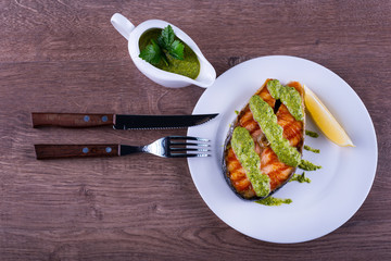 salmon steak grilled with sauce chimichurri