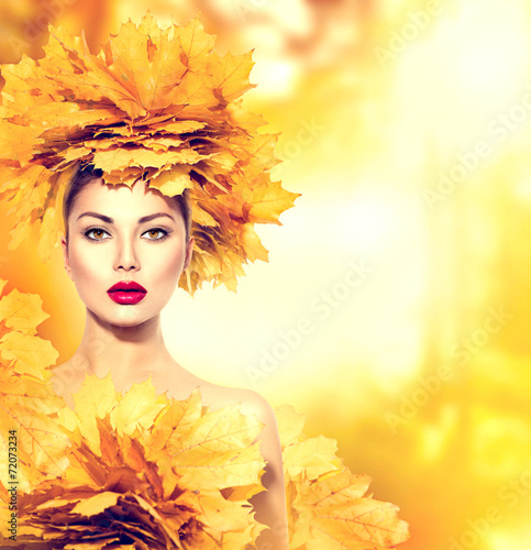 canvas print picture Autumn woman with yellow leaves hairstyle. Fall. Creative makeup